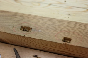 Enlarged mortise and dent on the left; initial mortise on the right.