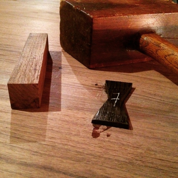 A block of wood and my old Lignum Vitae joiner's mallet easily seated each butterfly.